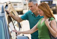 Photo: Couple shopping for car